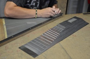 Using templates, the parts for the pipes are cut from the flat metal.
