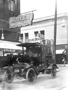 A new delivery truck proudly displayed in front of the Butler Music Company - about 1913.